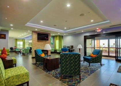 Spacious lobby with sitting area | Comfort Inn & Suites Tulsa I-44 West - Rt 66