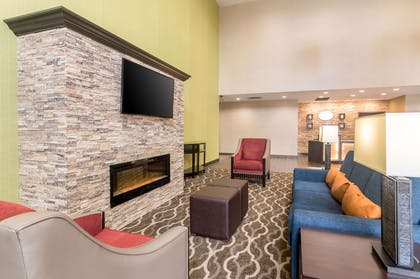 Spacious lobby with sitting area | Comfort Suites Airport on Meridian