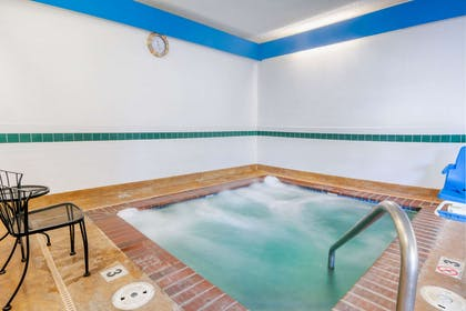 Relax in the hot tub | Comfort Inn North