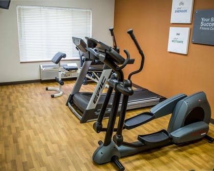 Fitness center with television | Comfort Suites Southwest