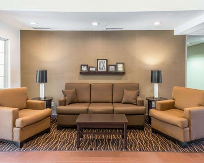 Spacious lobby with sitting area | MainStay Suites Pittsburgh Airport