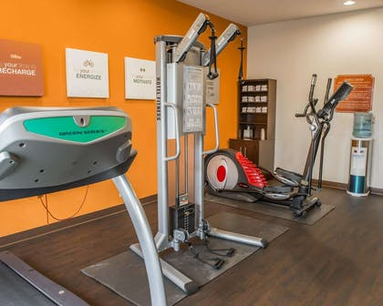 Fitness center with cardio equipment and weights | Comfort Suites Monaca