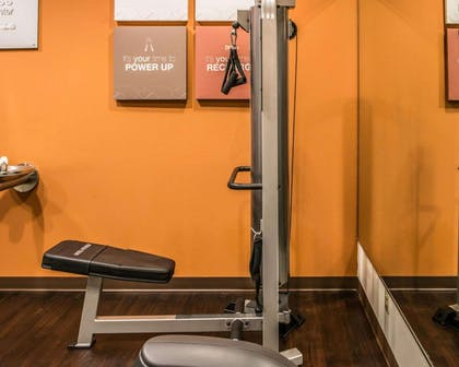 Fitness center with cardio equipment and weights | Comfort Suites Monroeville