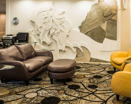 Spacious lobby with sitting area | Comfort Suites Monroeville