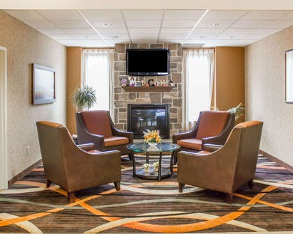 Relax by the fireplace in the lobby   Comfort Suites