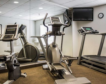 Exercise room with cardio equipment | Sleep Inn & Suites