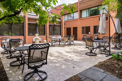 Enjoy the outdoor courtyard area | Quality Inn & Suites
