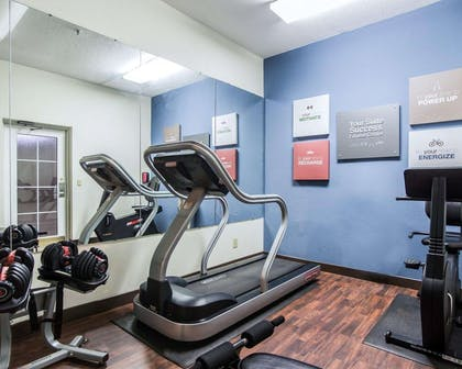 Fitness center with cardio equipment and weights | Comfort Suites Sumter