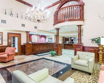 Spacious lobby with sitting area | Comfort Suites Sumter