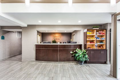 Spacious lobby with sitting area | MainStay Suites Greenville Airport