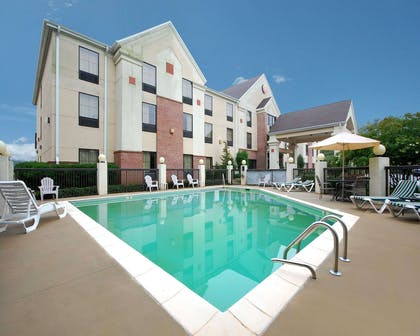 Outdoor pool with sundeck | Comfort Inn & Suites at I-85