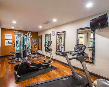Fitness center with cardio equipment and weights | Comfort Suites Simpsonville