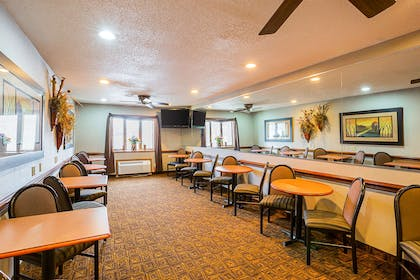 Enjoy breakfast in this seating area | Quality Inn Mitchell