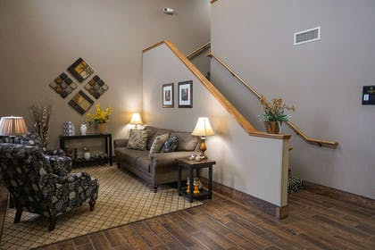 Spacious lobby with sitting area | Quality Inn & Suites Watertown