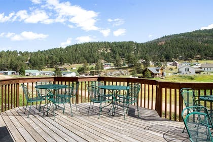 Relax on the hotel patio | Quality Inn Near Mount Rushmore