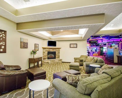 Relax by the fireplace in the lobby | Comfort Inn & Suites