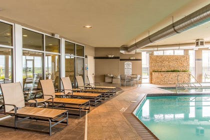 Relax by the pool | Cambria Hotel Rapid City near Mount Rushmore