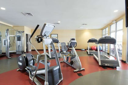 Exercise room with cardio equipment and weights | Cambria Hotel Rapid City near Mount Rushmore
