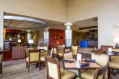 Enjoy breakfast in this seating area | Cambria Hotel Rapid City near Mount Rushmore