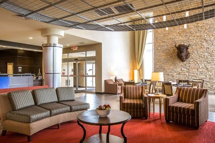Relax in the open space lobby with club-lounge seating | Cambria Hotel Rapid City near Mount Rushmore