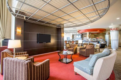 Catch up on the day in front of the large-screen media wall | Cambria Hotel Rapid City near Mount Rushmore