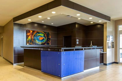 Modern front desk with a helpful and friendly staff | Cambria Hotel Rapid City near Mount Rushmore