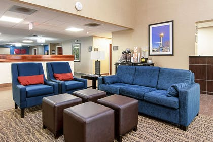 Lobby with sitting area | Comfort Suites Airport