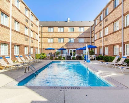 Outdoor pool with sundeck | MainStay Suites Brentwood