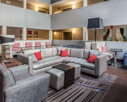 Spacious lobby with sitting area | Quality Suites Nashville Airport