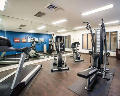 Fitness center with cardio equipment and weights   Comfort Suites Airport