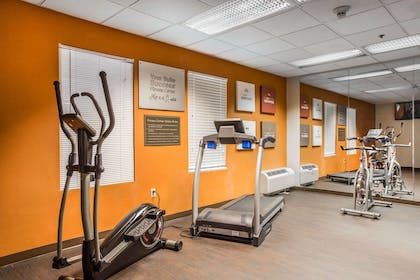 Exercise room with cardio equipment and weights | Comfort Suites Mountain Mile Area