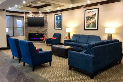 Spacious lobby with sitting area | Comfort Suites Mountain Mile Area