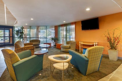 Spacious lobby with television | Comfort Suites Knoxville West - Farragut