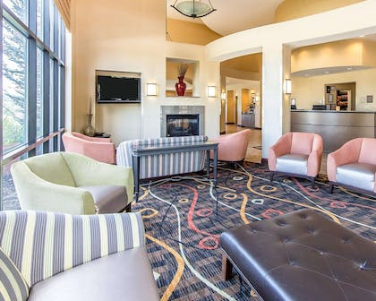 Spacious lobby with sitting area | Comfort Suites Kodak Sevierville