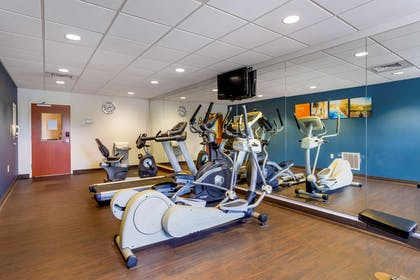 Exercise room with cardio equipment | Comfort Suites North