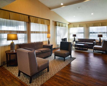 Spacious lobby with sitting area | Comfort Suites DFW Airport