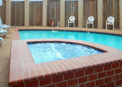 Outdoor pool with hot tub | Comfort Suites DFW Airport