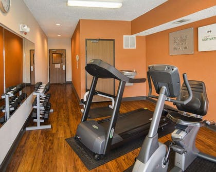 Fitness center with cardio equipment and weights | Comfort Suites DFW Airport