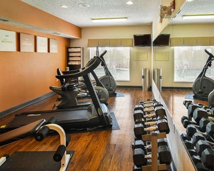 Fitness center with television | Comfort Suites DFW Airport