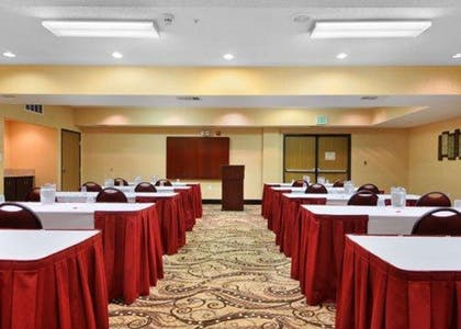 Meeting room with classroom-style setup | Comfort Suites DFW Airport