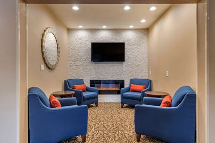 Spacious lobby with sitting area | Comfort Suites Lufkin