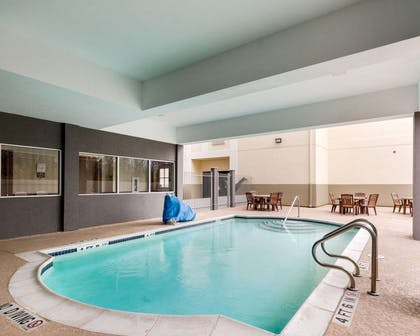 Outdoor pool with sundeck | Comfort Suites Bush Intercontinental Airport