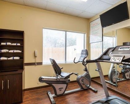 Fitness center with cardio equipment and weights | Comfort Suites Bush Intercontinental Airport