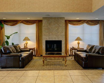 Lobby with fireplace | Comfort Inn & Suites