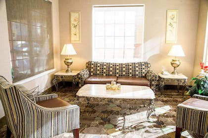 Spacious lobby with sitting area   Comfort Suites North Fossil Creek