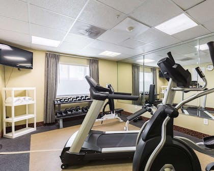 Exercise room with cardio equipment | Econo Lodge Inn & Suites East