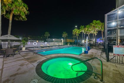 Night view of pool | Comfort Suites South Padre Island