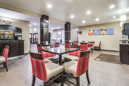 Enjoy breakfast in this seating area | Comfort Inn & Suites Love Field - Dallas Market Center