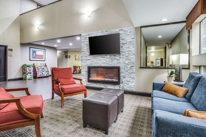 Spacious lobby with sitting area | Comfort Inn & Suites Love Field - Dallas Market Center
