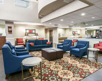 Spacious lobby with sitting area | Comfort Suites Willowbrook